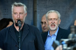 Jeremy Corbyn and Billy Bragg sing the 'The Red Flag' at the 'Solidarity With Refugees' demonstration.