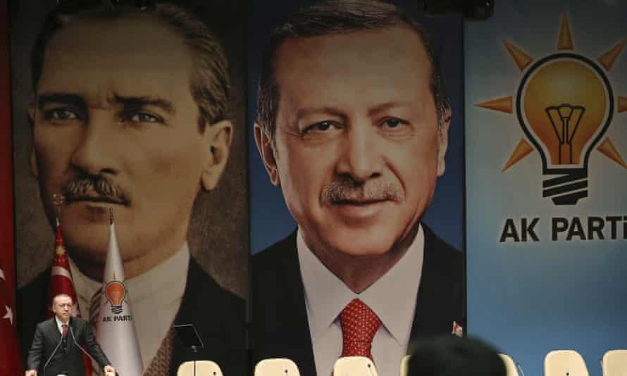 Turkey's president Recep Tayyip Erdoğan, in front of posters of Mustafa Kemal Ataturk. Nato has apologised for depicting them as 'enemies'