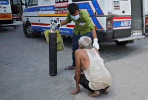 Ahmedabad, India. A patient with breathing problems is helped by his relative to enter a Covid-19 hospital for treatment