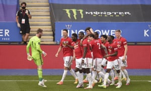 Manchester United players celebrate after Jesse Lingard's goal sealed victory over Leicester.