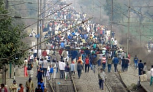 People from Jat community block the rail track near Sonipat railway station in Haryana