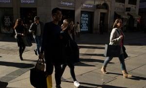 Shoppers walk down Gran Via street during 'Black Friday' in Madrid, Spain.