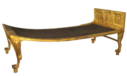 A gilded wooden bed