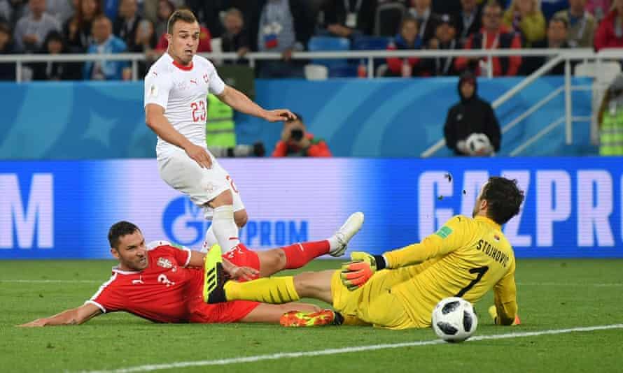 Xherdan Shaqiri squeezes the ball past Vladimir Stojkovic to score a late winner for Switzerland.
