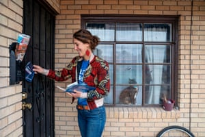 Olivia DiNucci, volunteer for the Bernie Sanders campaign, leaves a pamphlet at a residence on the day of the presidential primary in El Paso, Texas on Super Tuesday, March 3, 2020.