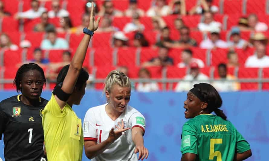England's Toni Duggan points to spit on her arm to referee Qin Liang.