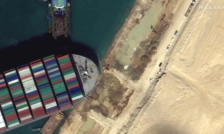 This satellite image from Maxar Technologies shows the cargo ship MV Ever Given stuck in the Suez Canal