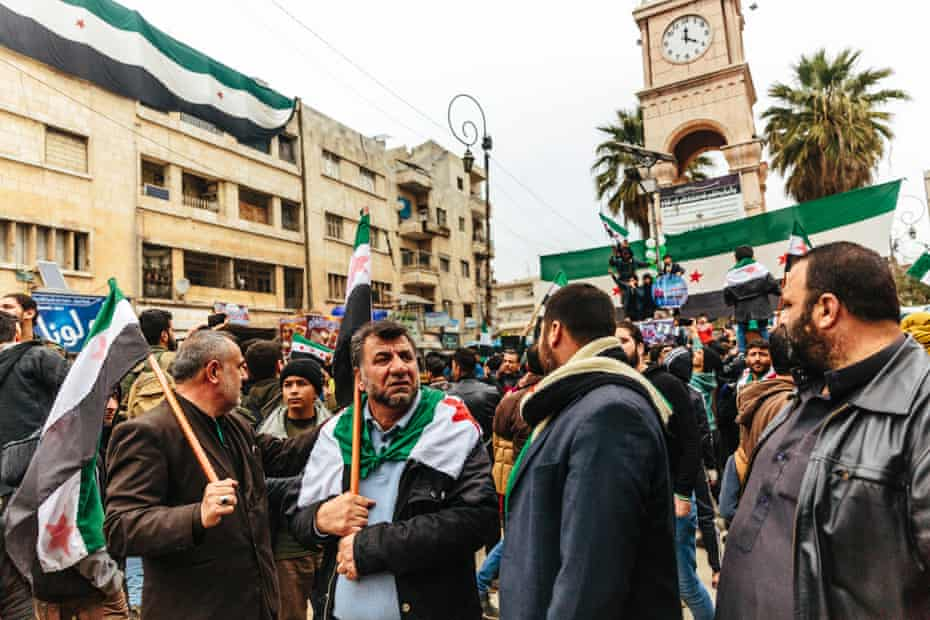 Men take part in a demonstration against the Syrian president Bashar al-Assad and his government in the city of Idlib.