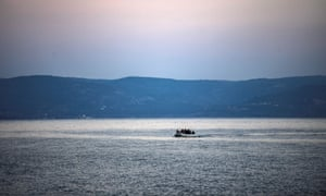 An inflatable boat carrying refugees approaches the Greek island of Lesbos, on 2 March 2020.
