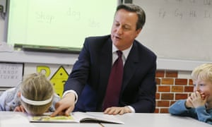 Lucy Howarth reads a book with David Cameron