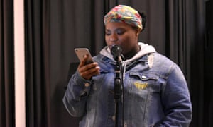 Dymond Henry (16), performs at the open mic.