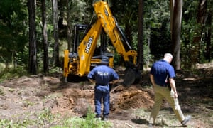 Police and forensic officers continue their search at the site where Matthew Leveson may be buried, in the Royal national park, near Waterfall south of Sydney on Sunday.