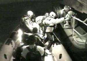 CCTV still showing dozens of schoolchildren being rescued.