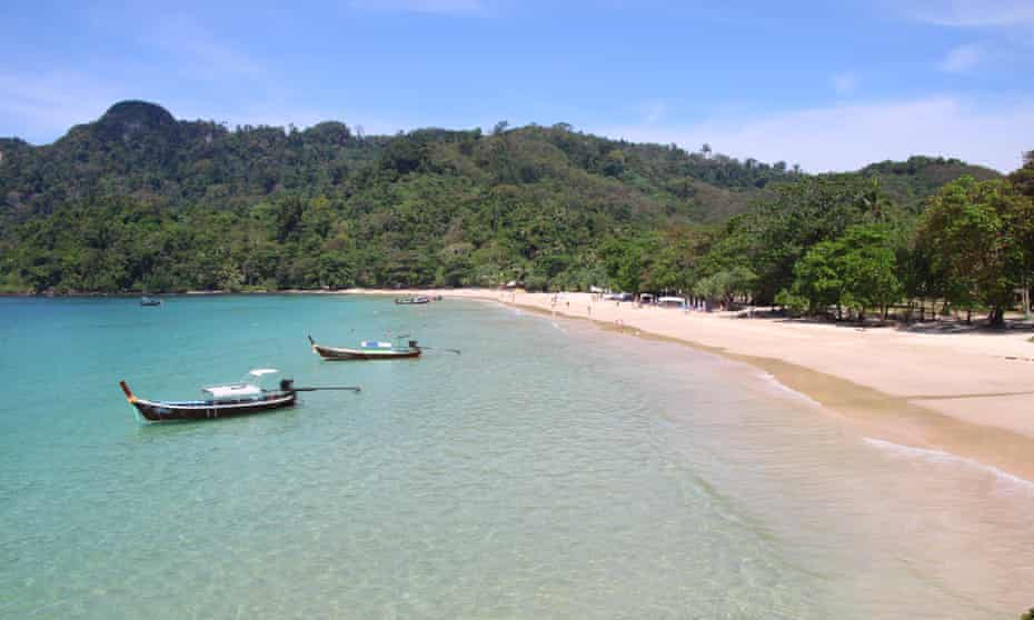 Tranquil Trang … the bay of Haad Farang, Koh Muk, with two longtail boats anchored just off the beach. Thailand.