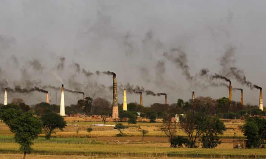 Smoke rises from brick kiln chimneys in Delhi.