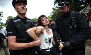 Police officers arrest anti-fracking protesters outside a drill site in Balcombe, West Sussex