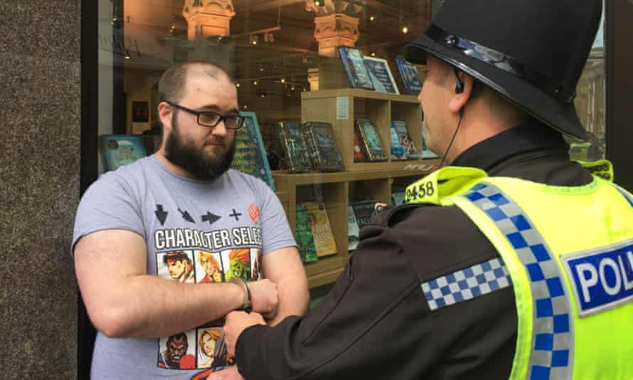 Paul Crowthe being spoken to by police after Nigel Farage was hit with a milkshake