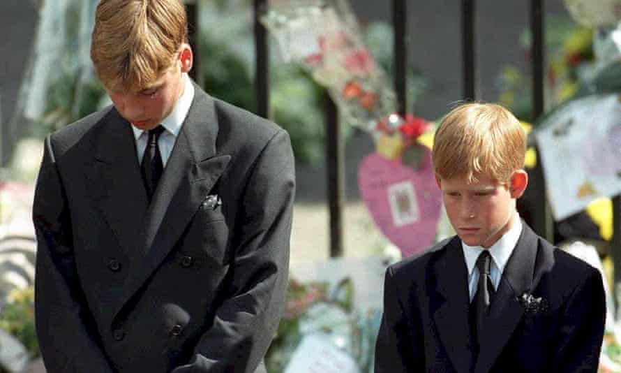 Harry (right) and Prince William bow their heads as their mother's coffin is removed from Westminster Abbey after her funeral service in 1997