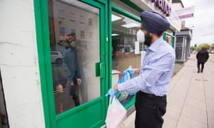 Charan Sekhon of the Seva Trust, based in Bedford, provides a student with a food parcel