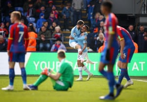 Manchester City's Gabriel Jesus celebrates with Bernardo Silva after scoring City third goal to beat Crystal Palace 3-1 at Selhurst Park.