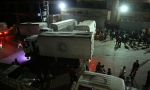 Aid workers unload food and other supplies in Madaya