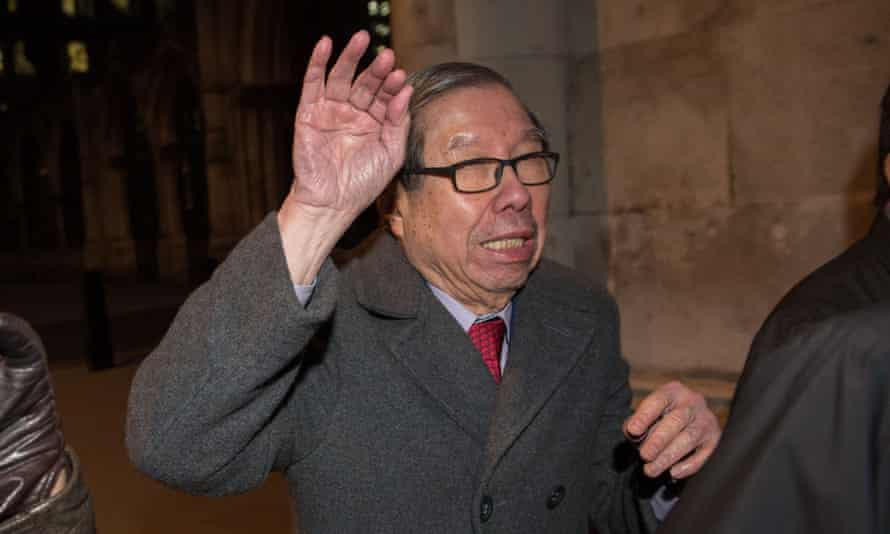 Khoo Kay Peng, non-executive chairman of Laura Ashley, leaves the high court in London.
