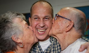 Peter Greste is kissed by his mother and father