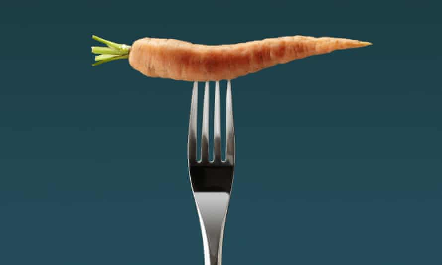 A carrot on the end of a fork
