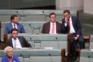 Darren Chester talks with the member for Dawson, George Christensen, as the House of Representatives resumes sitting in Parliament House