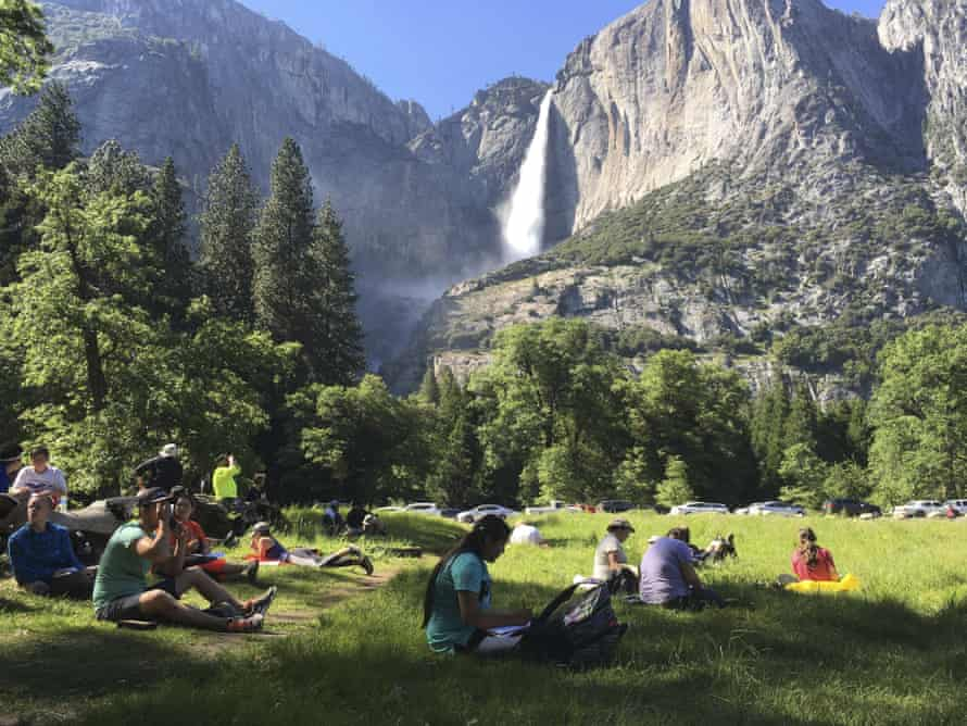 Visitors near Yosemite Falls. The park has just a few rangers and a limited number of restrooms.
