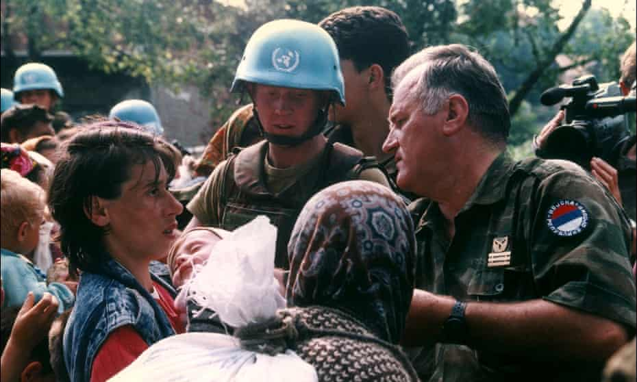 Ratko Mladic in Srebrenica on July 12, 1995. 'He reassured panicked captive Muslim women that their loved ones would be safe at the same time his soldiers were rounding up and slaughtering 8,000 husbands and sons.'