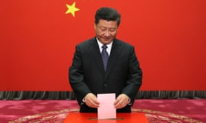 Xi Jinping casts his ballot at a voting booth during a local people's congress election in 2016