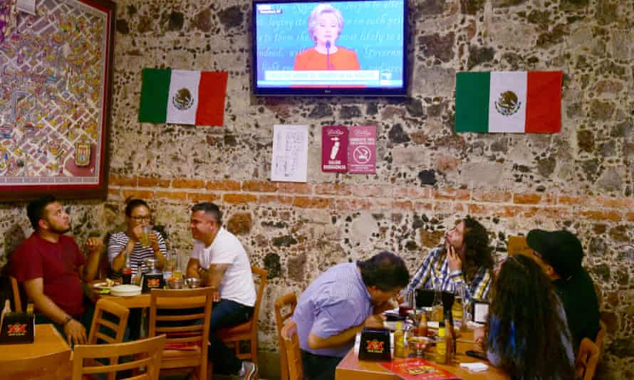 Mexicans watch the presidential candidates debate on television in a restaurant in Mexico City.