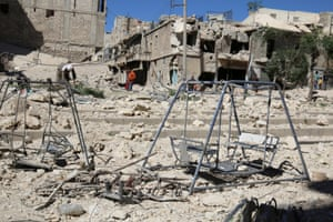 Swings are seen in a damaged site after airstrikes