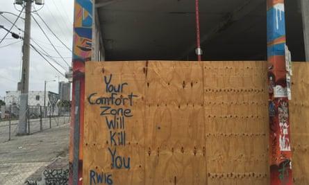 Graffiti adorns a warehouse apparently under construction .