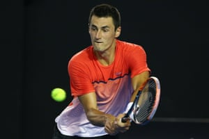 Tomic plays a backhand.
