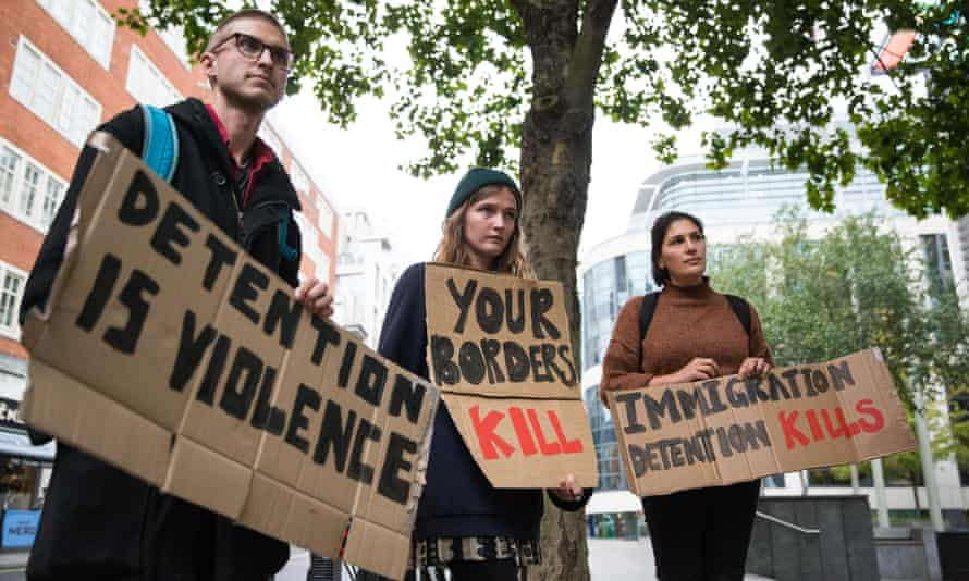 Campaigners in London protest against immigration detention.