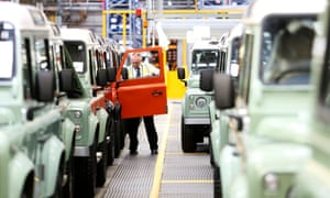 A worker performs quality control checks on Land Rover vehicles at the Tata Motors plant in Solihull, UK
