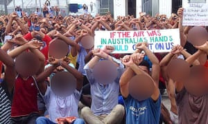 Australian Greens senator Nick McKim sits among detained asylum seekers and refugees as they hold a protest inside the Manus Island detention centre in Papua New Guinea in October 2017.