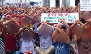 Australian Greens senator Nick McKim sits among refugees and asylum seekers refusing to leave the Manus Island detention centre in Papua New Guinea.