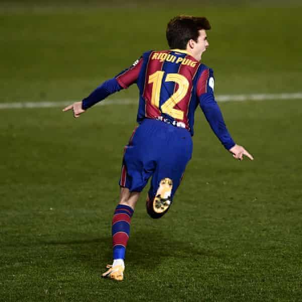 Riqui Puig celebrates his winning penalty.