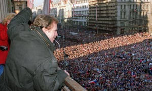 Vaclav Havel waves to thousands of demonstrators gathered on Prague's Wenceslas Square, celebrating the communist capitulation and nomination of the new government formed by Marian Calfa, 10 December 1989.