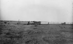 A steam train passing Garstang's camp at Meroë, which is visible in the background. Meroë, 1911