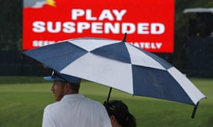 Spectators find shelter after play at Bellerive was suspended due to heavy rain.