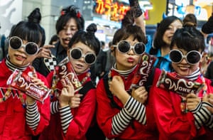 Women dressed as characters from Charlie and the Chocolate Factory gather in Tokyo's Shibuya district in Japan.