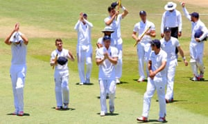 The England players celebrate their victory and applaud their supporters.