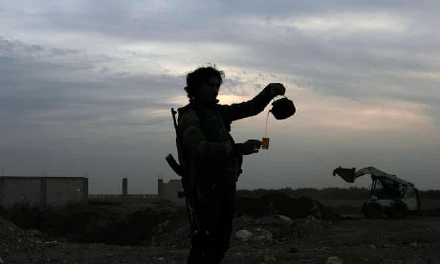 A Free Syrian army fighter pours tea in the rebel-held town of Dael.