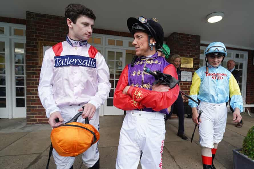 Murphy chats with Frankie Dettori as they leave the weighing room at Sandown Park.