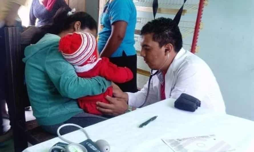 Dr Iván Cruz, 28, who died of coronavirus complications in Chiapas, Mexico, on 1 June attends to patients.