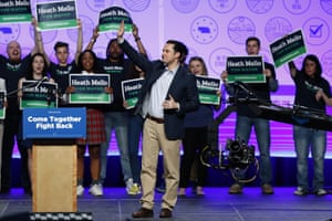 Heath Mello waves to supporters at a rally in Omaha last week. Mello says his personal views would never lead him to support new abortion restrictions.
